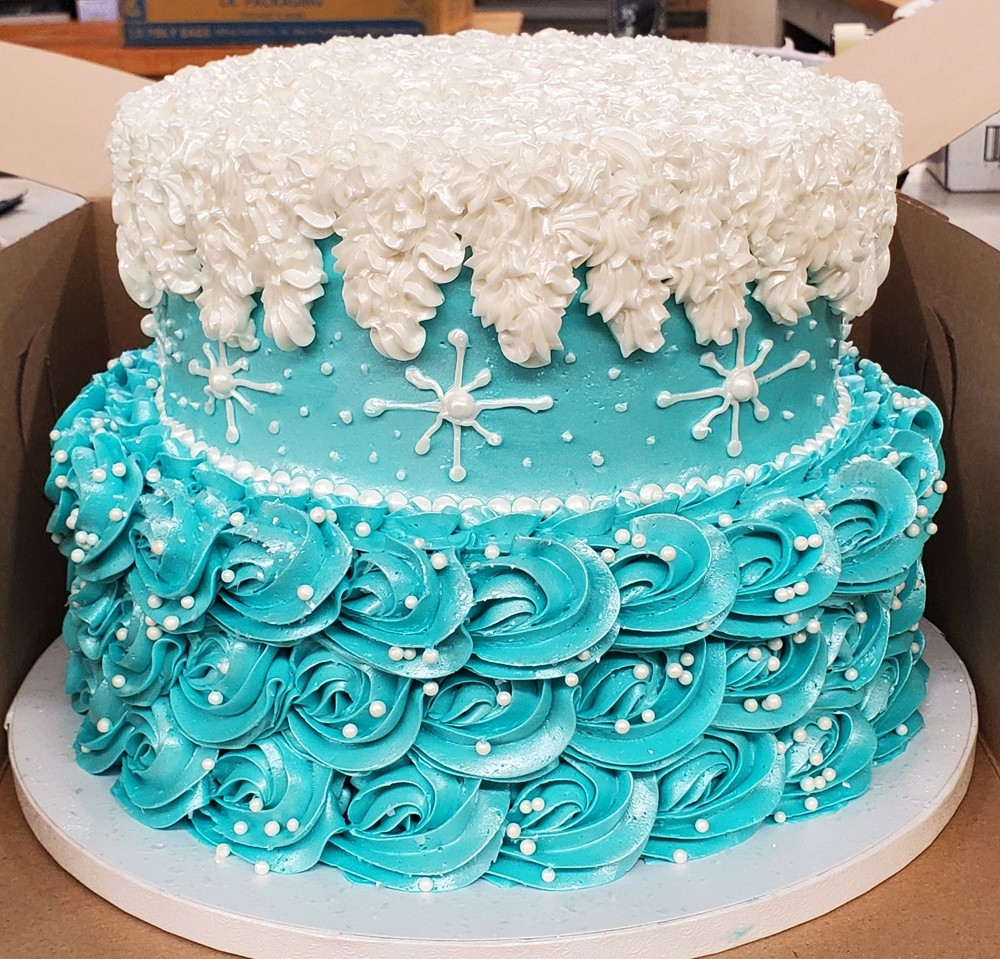 Textured blue and white two-tier cake
