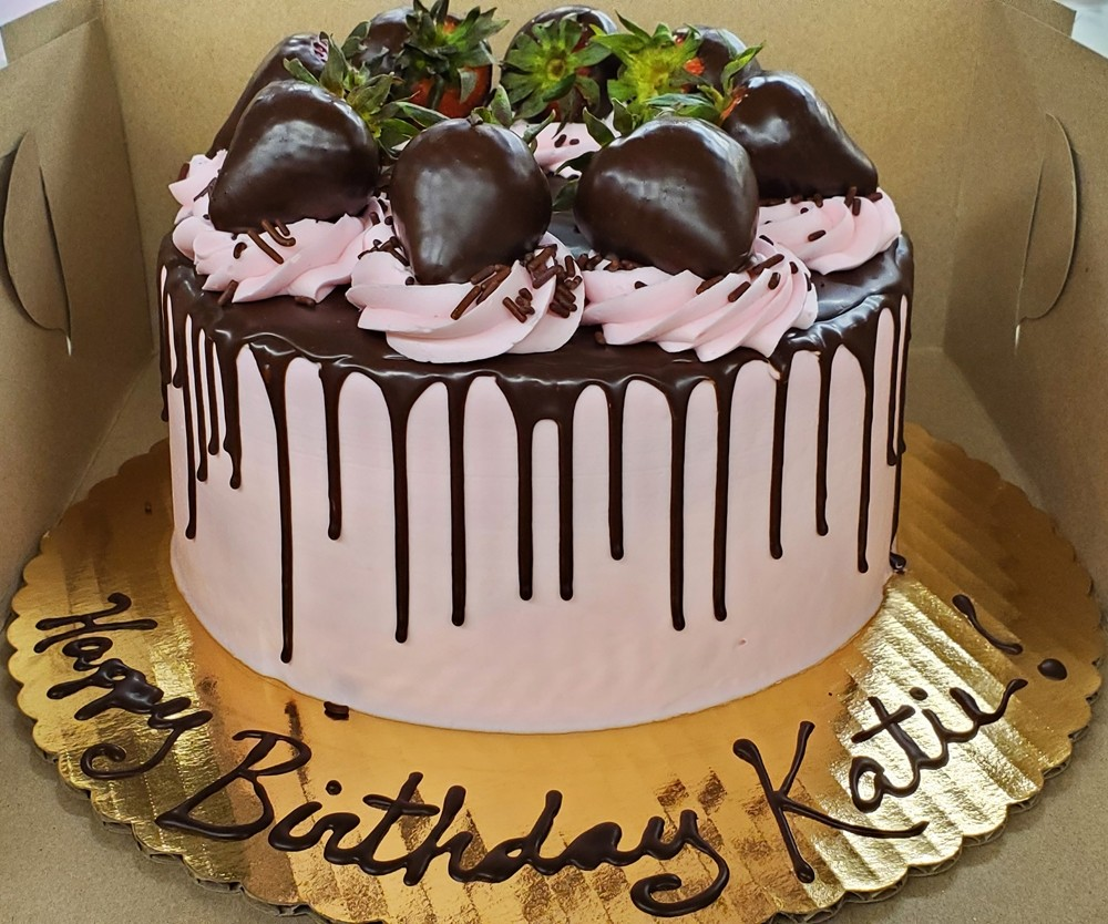 Birthday cake with chocolate covered strawberries