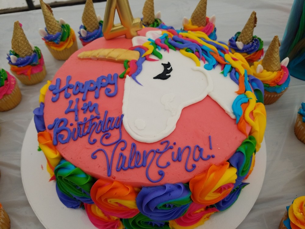 Birthday cake with a unicorn frosting design
