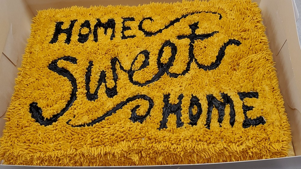 Home Sweet Home cake with frosting that makes it look like carpet